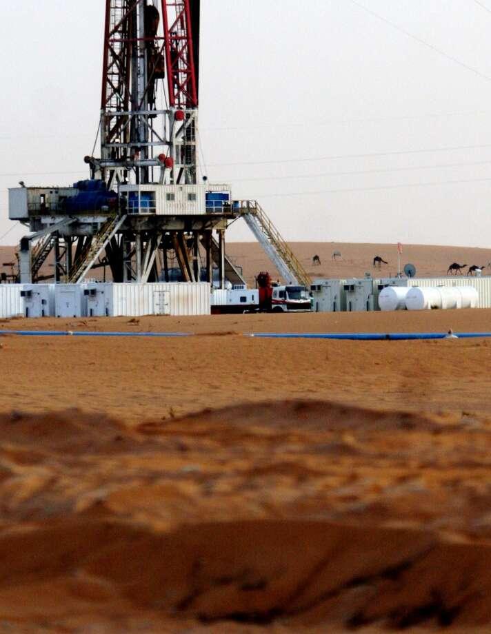 1. Saudi Arabia  Jan. - June 2013: $142 billion 2012: $311 billion  [Photo: Camels gather beyond an oil well near the Khurais oil facility, about 60 miles southeast of Riyadh, Saudi Arabia, Monday, June 23, 2008.] Photo: Hasan Jamali, AP