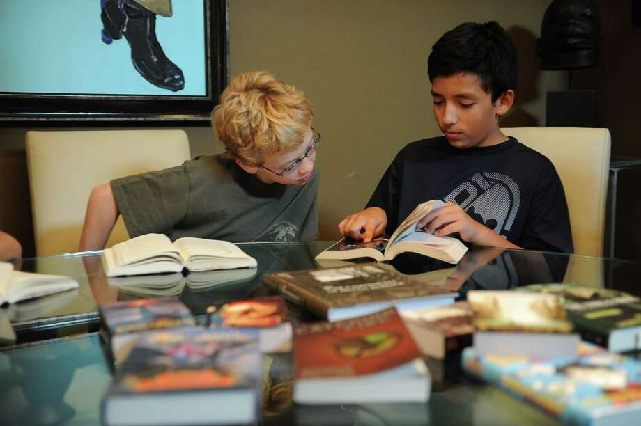 5th Grade Book Club members McKennon Denny, 12, left, and Aaron Schultz, 11, discuss a book they have read. Photo: Thomas Nguyen, Freelance / Freelance