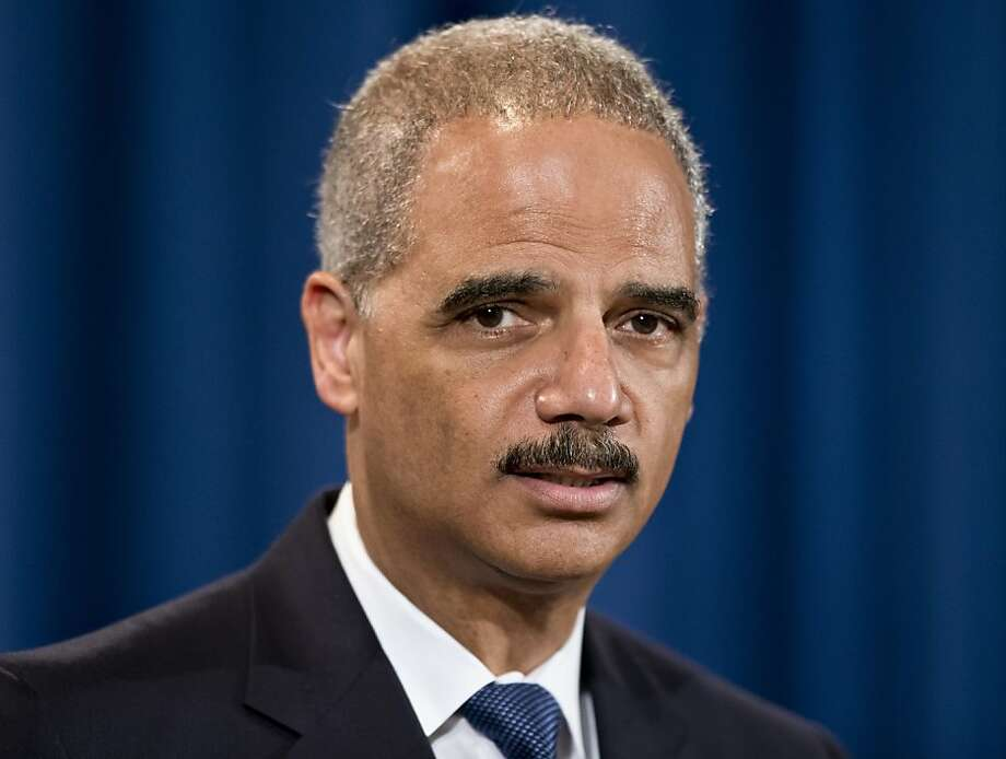 Attorney General Eric Holder expresses disappointment in the Supreme Court's 5-4 ruling in the Alabama voting rights case, Shelby County v. Holder, Tuesday, June 25, 2013, at the Justice Department in Washington. The court declared unconstitutional a provision of the landmark Voting Rights Act that determines which states and localities must get Washington's approval for proposed election changes. (AP Photo/J. Scott Applewhite) Photo: J. Scott Applewhite, Associated Press