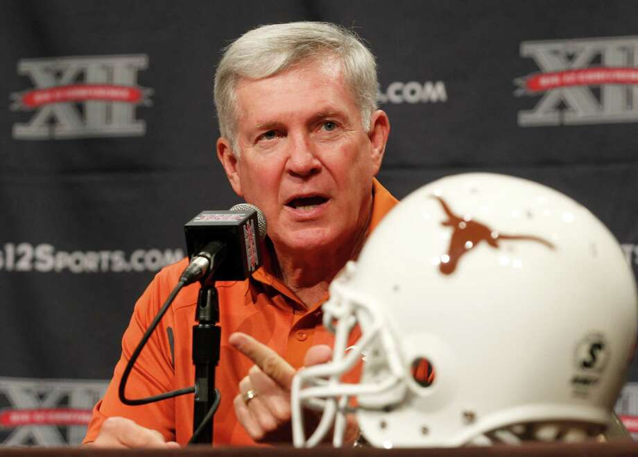Texas football coach Mack Brown addresses the media during the Big 12 Conference Football Media Days Monday, July 23, 2013 in Dallas.  (AP Photo/Tim Sharp) Photo: TIM SHARP, Associated Press / FR62992 AP