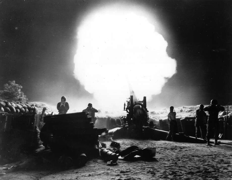 A dramatic shot of 155mm Howitzer fire during night action in the Korean War. Photo: Keystone, Getty Images / Hulton Archive