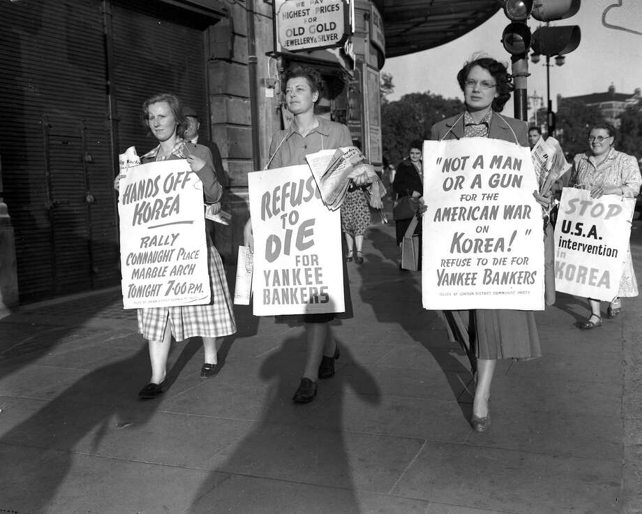 Women with placards demonstrating against the Korean War, as part of the Communist Peace Demonstration held at Marble Arch London. Photo: Keystone, Getty Images / Hulton Archive