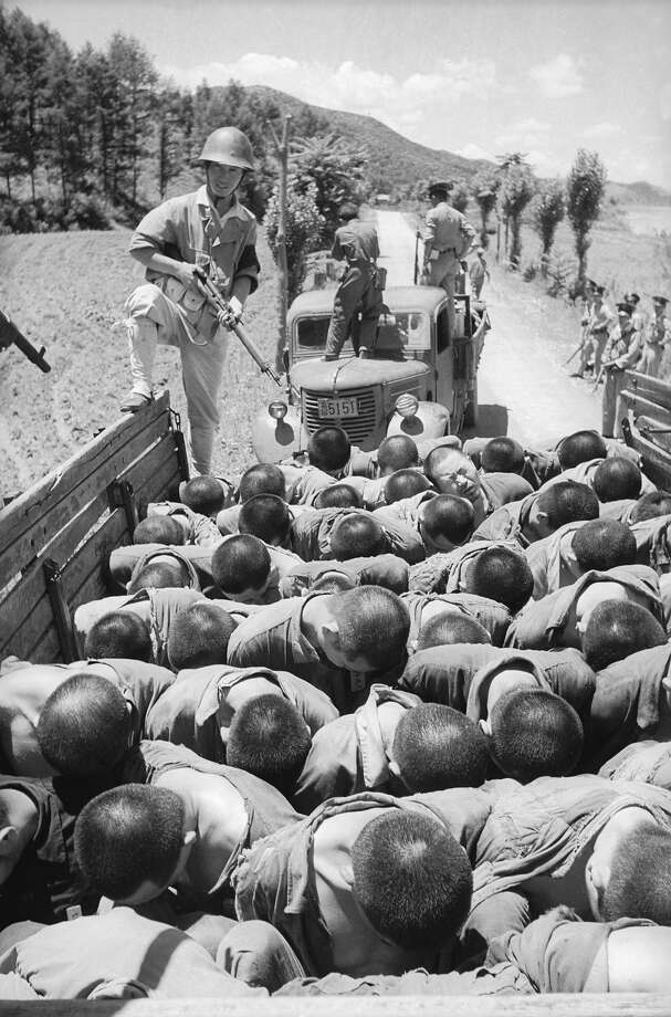 Suspected South Korean traitors are herded into lorries on their way to execution - an incident that was later investigated by a United Nations observer. Photo: Haywood Magee, Getty Images / Picture Post