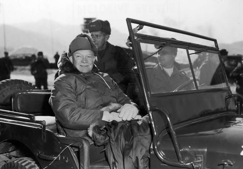 President Elect Dwight Eisenhower (1890 - 1969) and General Mark Clark (back seat, 1896 - 1984), in a jeep during their tour of installations of the 2nd US Infantry Division on a visit to United Nations units along the fighting front during the Korean War. Photo: Hulton Archive, Getty Images / Archive Photos