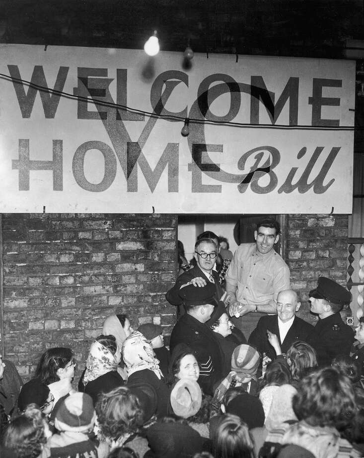 Private William Speakman is welcomed by crowds in his home town of Altrincham, 31st January 1952, after his return from military service in Korea, where his actions won him the Victoria Cross for gallantry. Photo: Hulton Archive, Getty Images / 2003 Getty Images