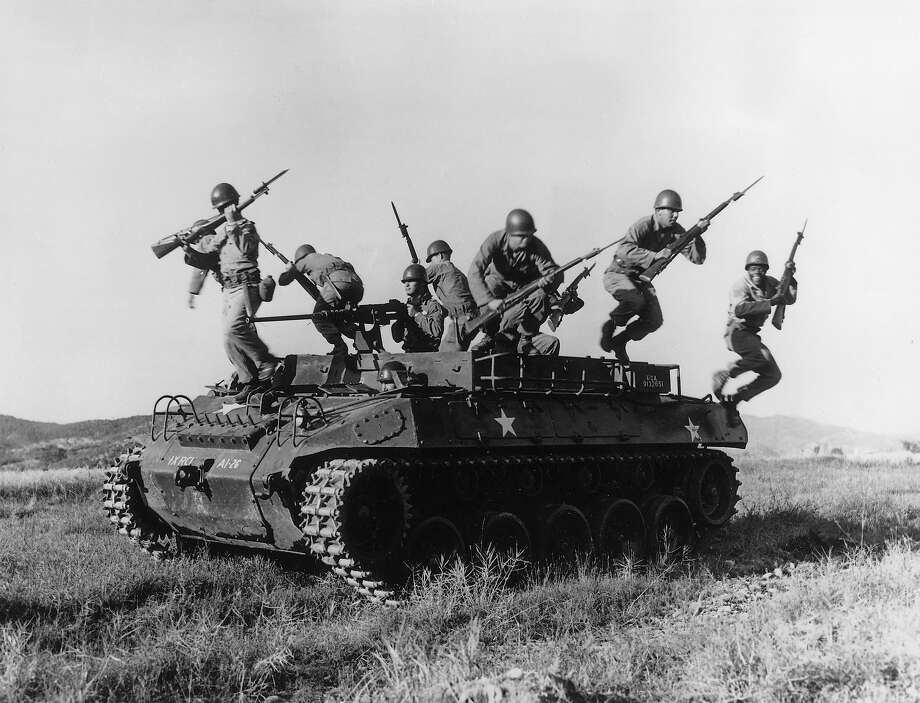 American soldiers leaping from an armored personnel carrier during exercises in Korea. Photo: Three Lions, Getty Images / Hulton Archive