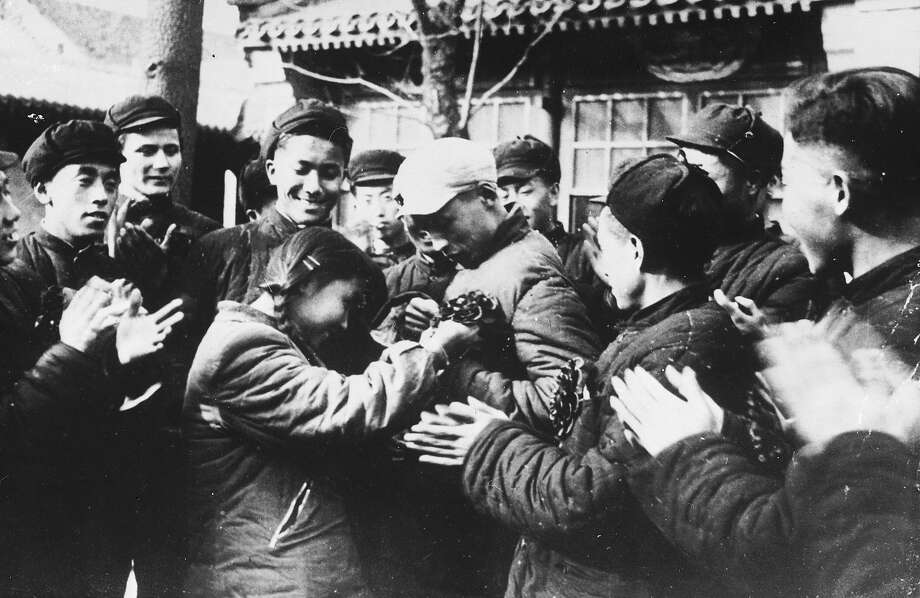University volunteers are given a rousing send off by fellow students as they leave Peking for the Korean War. Photo: Keystone, Getty Images / Hulton Archive