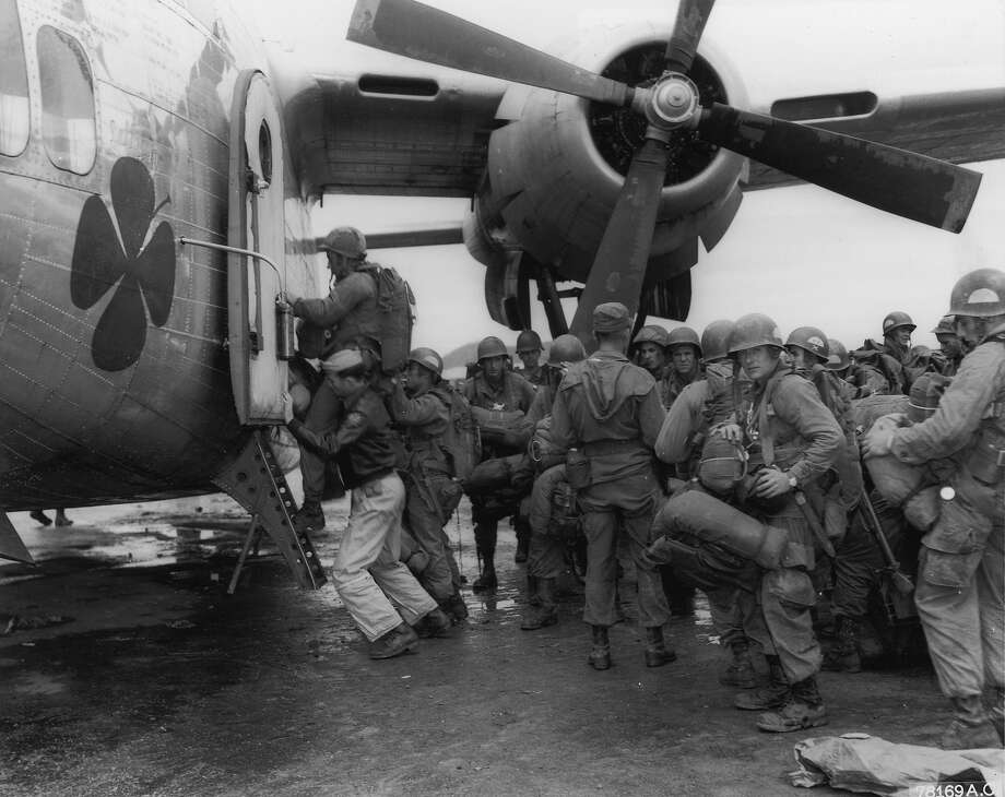 U.S. Air Force paratroopers wait to board an air cargo carrier at Kimpo Airfield, preparing for a combat jump north of Pyongyang, the capital of North Korea, during the Korean War. Photo: Consolidated News Pictures, Getty Images / Archive Photos