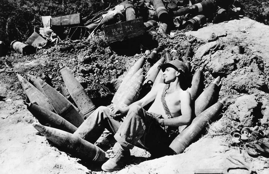An American soldier sleeps on his ammunition in the Mason area during the Korean war. Photo: Keystone, Getty Images / Hulton Archive