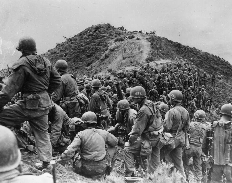 Men of the 187th US Regimental Combat Team prepare to take a ridge position somewhere in Korea. Photo: Keystone, Getty Images / Hulton Archive