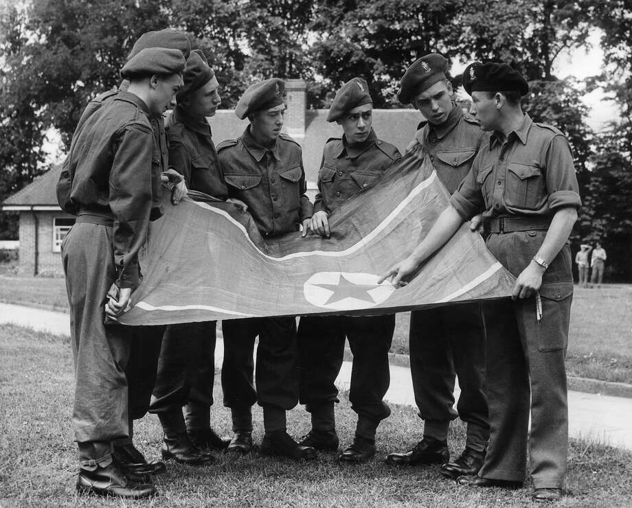 Rifleman E Akid showing national service recruits a captured Korean flag at the Royal Ulster Rifles Depot in Ballymena, County Antrim, Northern Ireland. Photo: MacMullan, Getty Images / Hulton Archive