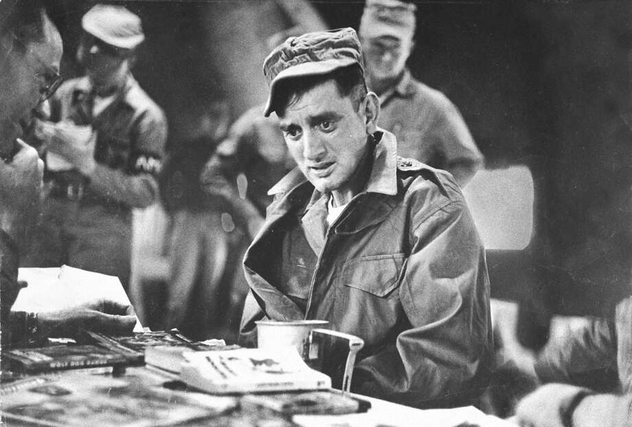 Army Pfc. John Ploch, one of the returned Americans who had not been reported a POW, sitting at table in dazed disbelief as he is processed during Korean War prisoner exchange at Freedom Village. Photo: Michael Rougier, Time & Life Pictures/Getty Image / Time Life Pictures