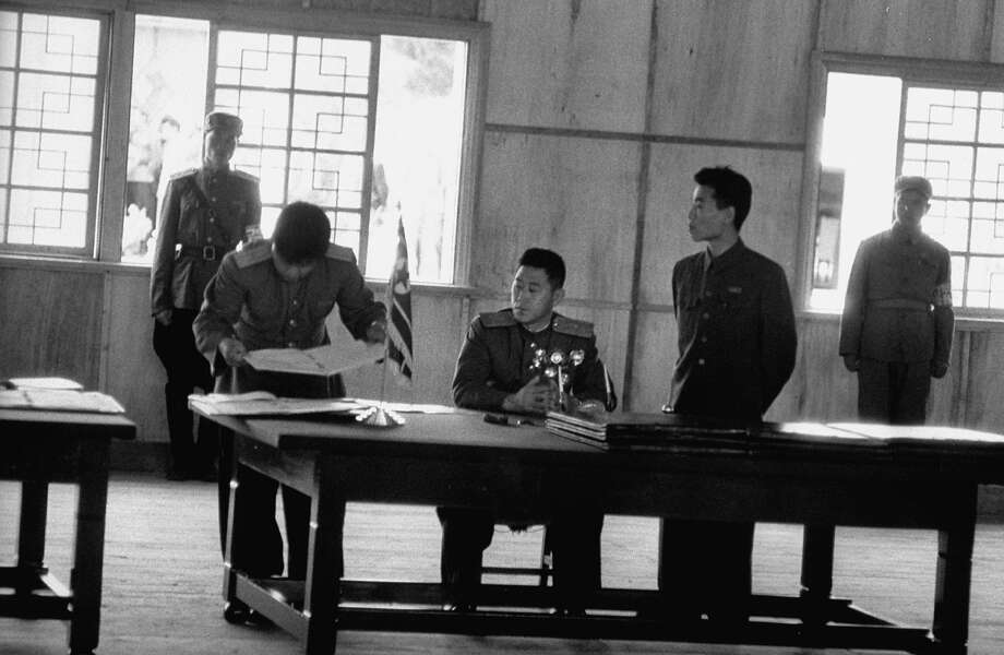 North Korean Communist Gen. Nam Il , chief negotiator of the Korean War Armistice, signing the agreement in the peace pagoda at Panmunjom. Photo: Michael Rougier, Time & Life Pictures/Getty Image / Time & Life Pictures