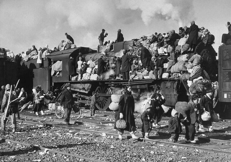 Refugees & their belongings fill a train fleeing war ravaged countryside re struggle between communist North Korean and democratic South Korean troops. Photo: Carl Mydans., Time & Life Pictures/Getty Image / Time & Life Pictures