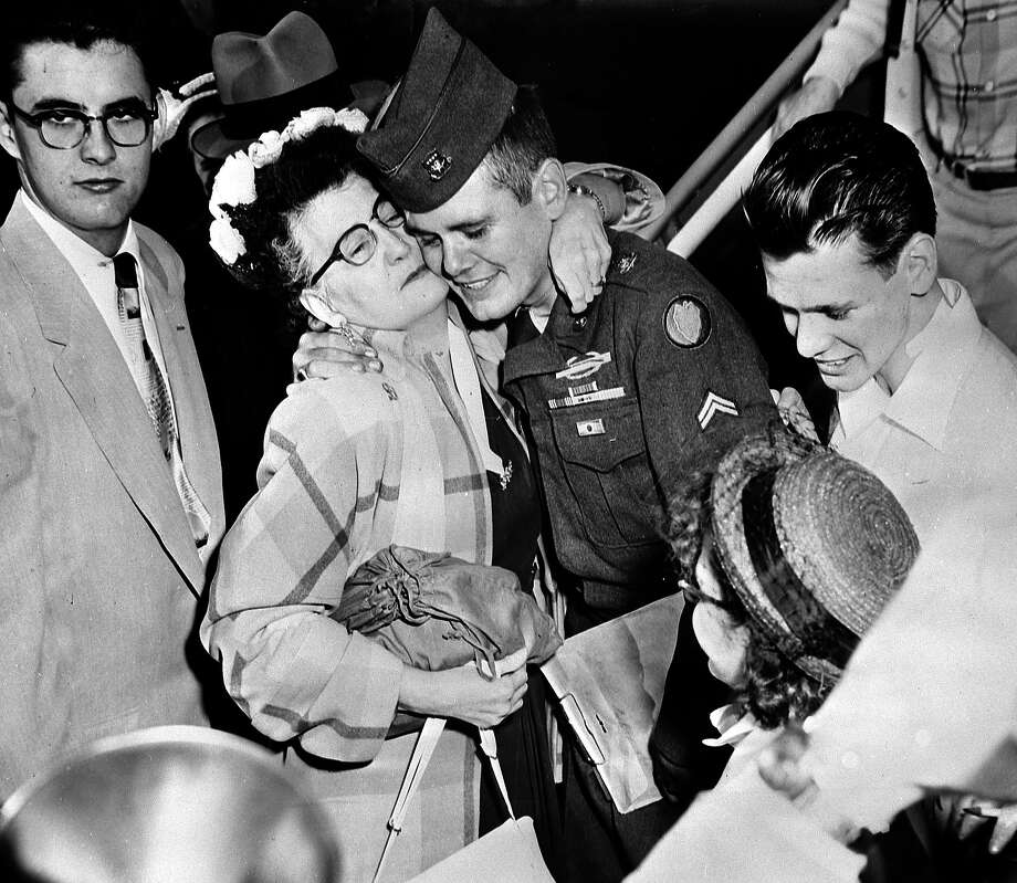 Sgt. Donald Legay gets a hero's welcome from his family on his return to America after spending 29 months in a communist prison camp after being captured in November 1950. Photo: Popperfoto, Popperfoto/Getty Images / Popperfoto