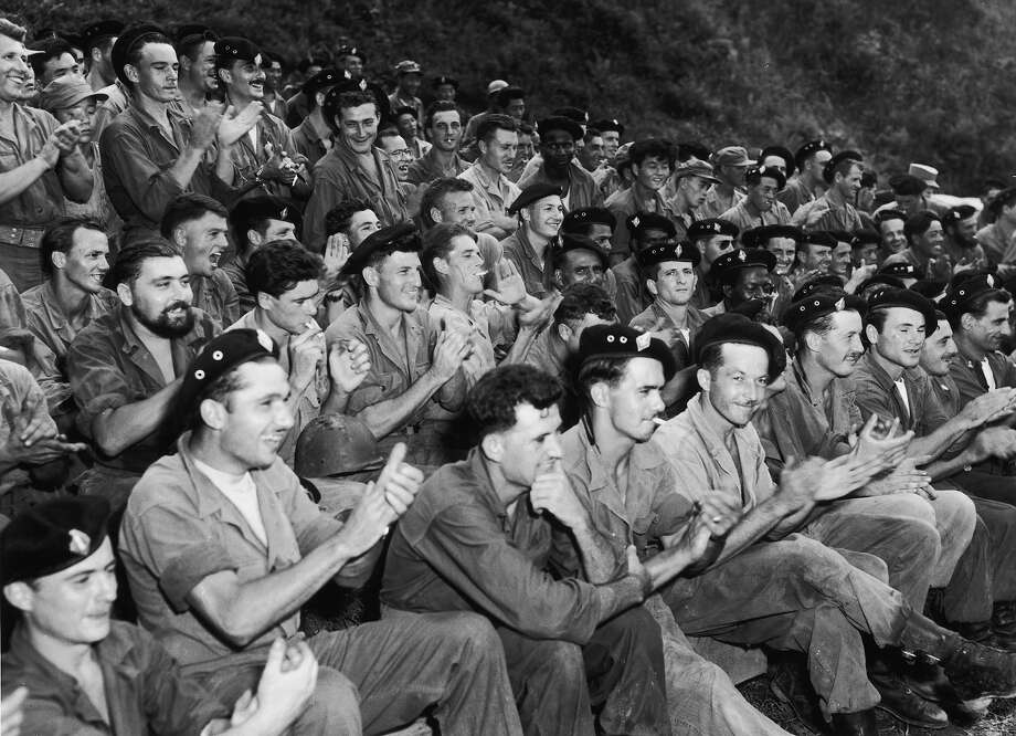 Members of the French Battalion of volunteer soldiers watch a performance by a French-Canadian entertainment unit during the Korean War, 1953. They are part of the United Nations fighting force in Korea. Photo: Fox Photos, Getty Images / 2008 Getty Images