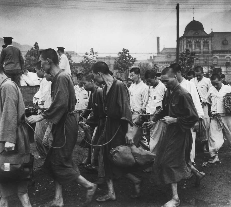 South Korean prisoners, held by the South Korean army during the Korean War at Pusan (Busan), where United Nations forces are based in South Korea, September 1950. They are political prisoners, arrested for their alleged sympathies with the communist north. Photo: Bert Hardy, Getty Images / 2008 Getty Images