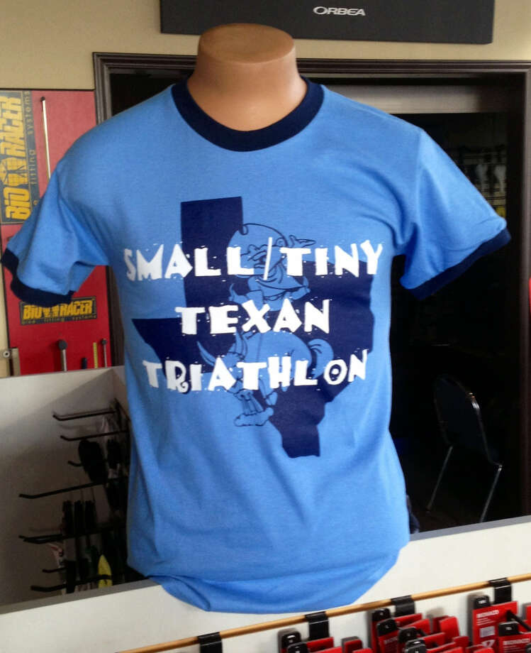Regardless of finish, everyone who signs up to compete in Sunday's Small Texan and Tiny Texan Triathlons at Boerne City Lake will receive one of this year's official event tee-shirts, as seen on display at Britton's Bicycle Shop. Photo: Photo Courtesy Of