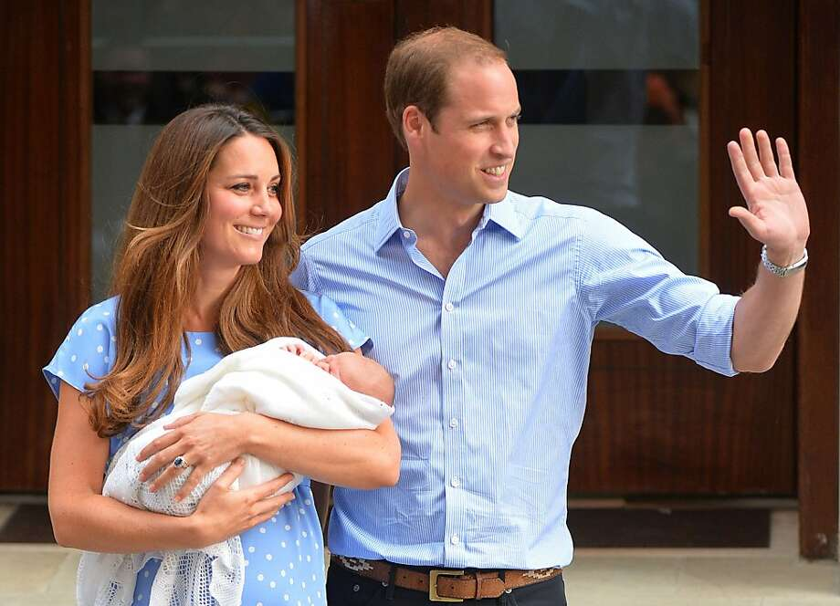 Well, except for the baldness: Prince William and Catherine, Duchess of Cambridge, briefly show the world their newborn son outside St. Mary's Hospital in London. William said the prince had Kate's looks. Photo: Leon Neal, AFP/Getty Images