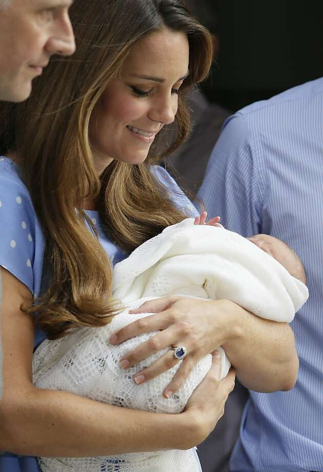 Kate, Duchess of Cambridge holds the Prince of Cambridge, Tuesday July 23, 2013, as they pose for photographers outside St. Mary's Hospital exclusive Lindo Wing in London where the Duchess gave birth on Monday July 22. The Royal couple are expected to head to London's Kensington Palace from the hospital with their newly born son, the third in line to the British throne. Photo: Alastair Grant, Associated Press