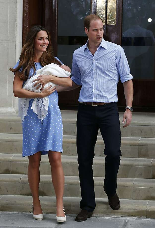 Britain's Prince William and Kate, Duchess of Cambridge hold the Prince of Cambridge, Tuesday July 23, 2013, as they pose for photographers outside St. Mary's Hospital exclusive Lindo Wing in London where the Duchess gave birth on Monday July 22. The Royal couple are expected to head to London's Kensington Palace from the hospital with their newly born son, the third in line to the British throne. Photo: Lefteris Pitarakis, Associated Press