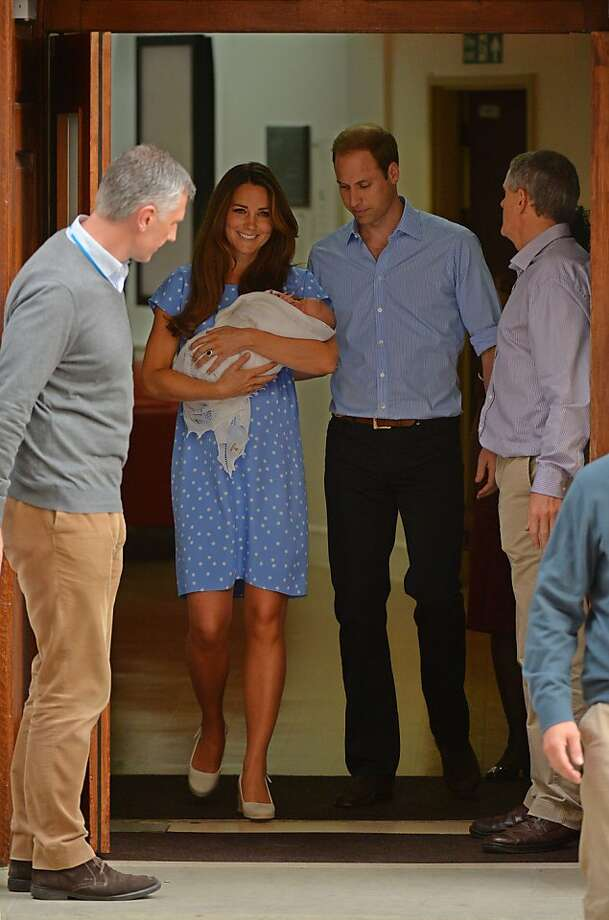 Prince William and Catherine, Duchess of Cambridge show their new-born baby boy to the world's media, leaving the Lindo Wing of St Mary's Hospital in London on July 23, 2013. The baby was born on Monday afternoon weighing eight pounds six ounces (3.8 kilogrammes). The baby, titled His Royal Highness, Prince of Cambridge, is directly in line to inherit the throne after Charles, Queen Elizabeth II's eldest son and heir, and his eldest son William. Photo: Leon Neal, AFP/Getty Images