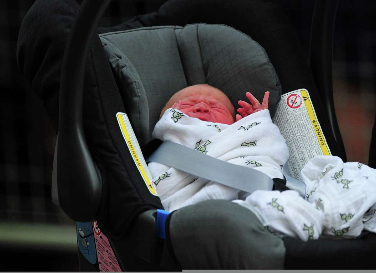 Prince William and Catherine, Duchess of Cambridge' new-born baby boy seen in a car seat outside the Lindo Wing of St Mary's Hospital in London on July 23, 2013. The baby was born on Monday afternoon weighing eight pounds six ounces (3.8 kilogrammes). The baby, titled His Royal Highness, Prince (name) of Cambridge, is directly in line to inherit the throne after Charles, Queen Elizabeth II's eldest son and heir, and his eldest son William. AFP PHOTO / CARL COURTCARL COURT/AFP/Getty Images