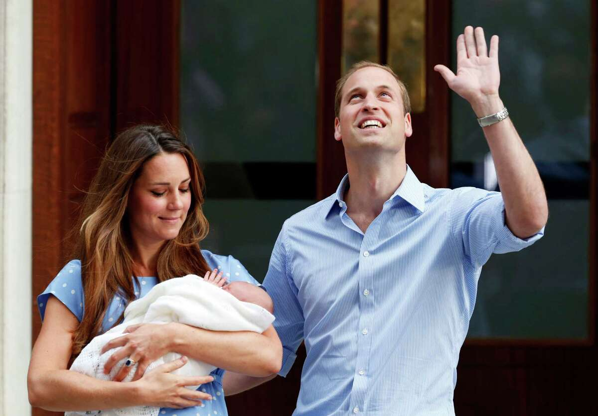 Britain's Prince William and Kate, Duchess of Cambridge hold the Prince of Cambridge, Tuesday July 23, 2013, as they pose for photographers outside St. Mary's Hospital exclusive Lindo Wing in London where the Duchess gave birth on Monday July 22. The Royal couple are expected to head to London's Kensington Palace from the hospital with their newly born son, the third in line to the British throne. (AP Photo/Lefteris Pitarakis) ORG XMIT: TH120