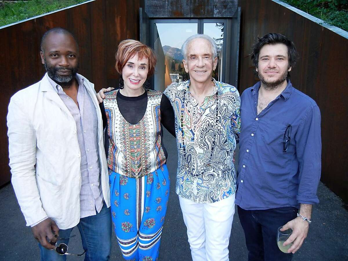 Artist Theaster Gates (at left) with art collectors, Norah and Norman Stone, and artist-DJ Jimmy Raskin at the Stone's 4th Stonescape exhibition-soiree in Calistoga. July 2013. By Catherine Bigelow