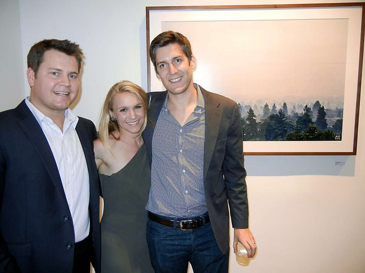 Gauntlet gallerist Luke Lombardo (at left) with Tatum Getty and her husband, photographer Alexander Getty at the opening of Getty's recent show. July 2013. By Catherine Bigelow
