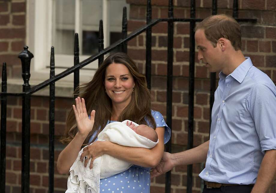 Britain's Prince William and Kate, Duchess of Cambridge hold the Prince of Cambridge, Tuesday July 23, 2013, as they pose for photographers outside St. Mary's Hospital exclusive Lindo Wing in London where the Duchess gave birth on Monday July 22. The Royal couple are expected to head to London's Kensington Palace from the hospital with their newly born son, the third in line to the British throne. Photo: Matt Dunham, Associated Press