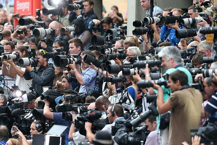 The massed ranks of the media capture the moment the Duke and Duchess of Cambridge leave the Lindo Wing of St Mary's Hospital in London, with their newborn son Tuesday July 23 2013.  Photo: Steve Parsons, Associated Press