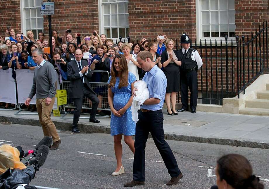 Prince William and Catherine, Duchess of Cambridge show their new-born baby boy to the world's media outside the Lindo Wing of St Mary's Hospital in London on July 23, 2013. The baby was born on Monday afternoon weighing eight pounds six ounces (3.8 kilogrammes). The baby, titled His Royal Highness, Prince (name) of Cambridge, is directly in line to inherit the throne after Charles, Queen Elizabeth II's eldest son and heir, and his eldest son William.  Photo: Andrew Cowie, AFP/Getty Images