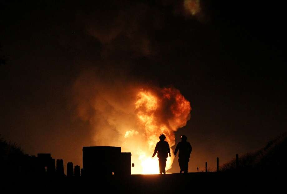 Firefighters work next to flames caused by the explosion of a gas pipeline in Zapotlanejo, Mexico on October 19, 2012. The explosion injured two people and forced the evacuation of 600 residents, according to local authorities. Photo: HECTOR GUERRERO, AFP/Getty Images