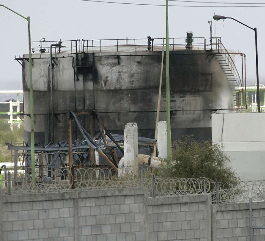 Severly burned out Pemex gas tanks at the Petroleos Mexicans pipeline distribution center on the outskirts of Reynosa, Mexico, reveals some of the extent of the damage caused by the fatal gas explosion, Wednesday Sept. 19, 2012. At least 26 people were killed. Photo: Delcia Lopez, Associated Press