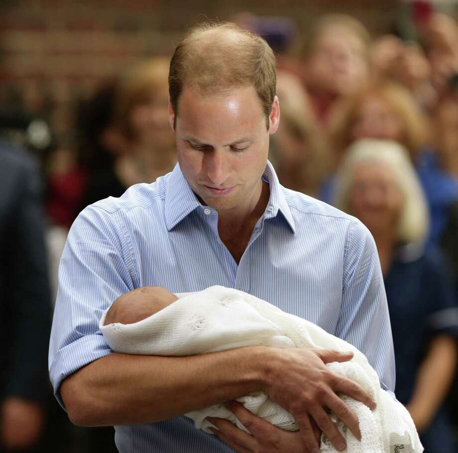 The Duke of Cambridge leaves the Lindo Wing of St Mary's Hospital in London Tuesday July 23 2013, carrying his new-born son, the Prince of Cambridge, who was born Monday, into public view for the first time. The boy will be third in line to the British throne. Photo: Yui Mok, PA