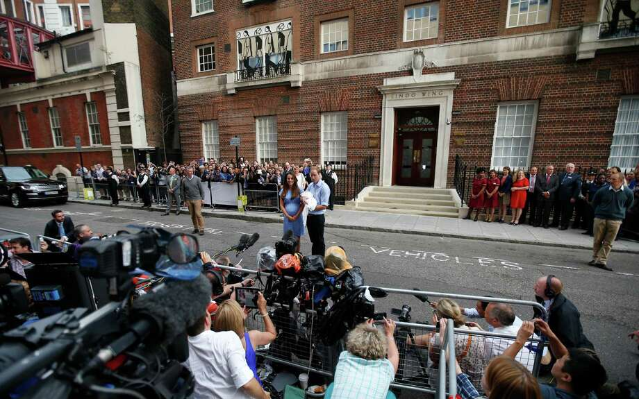 Britain's Prince William and Kate, Duchess of Cambridge hold the Prince of Cambridge, Tuesday July 23, 2013, as they pose for photographers outside St. Mary's Hospital exclusive Lindo Wing in London where the Duchess gave birth on Monday July 22. The Royal couple are expected to head to London's Kensington Palace from the hospital with their newly born son, the third in line to the British throne. Photo: Lefteris Pitarakis