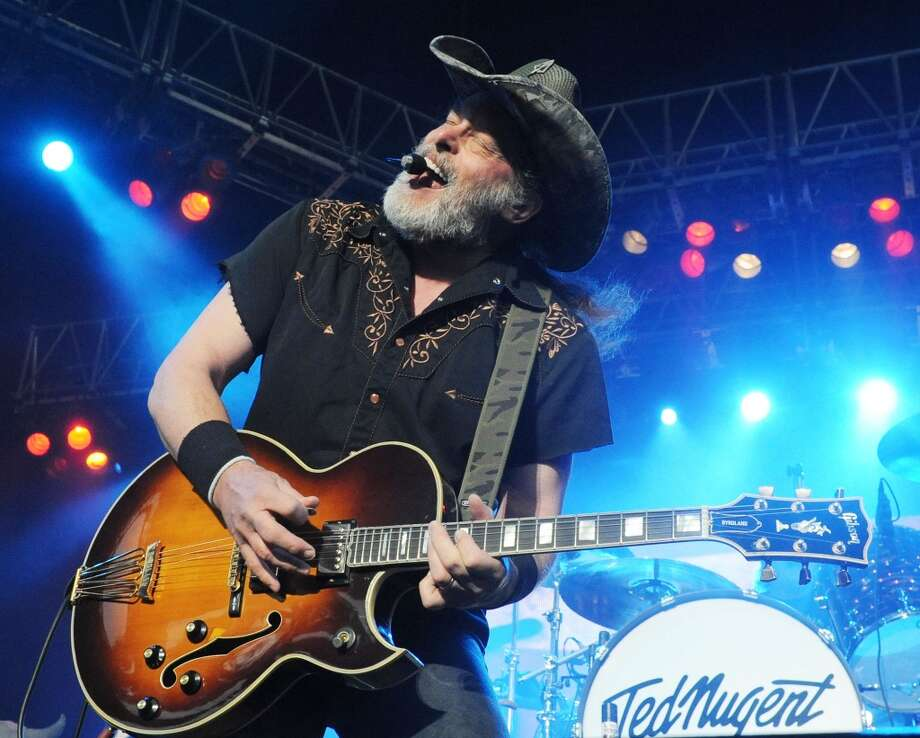 Ted Nugent performs at Verizon Wireless Amphitheater on May 5, 2013 in Alpharetta, Georgia. Dozens of people descended on Toad's Place on Tuesday, Aug. 6 to protest the southern rocker's performance in the wake of controversial remarks he made about Trayvon Martin. Photo: Chris McKay, WireImage