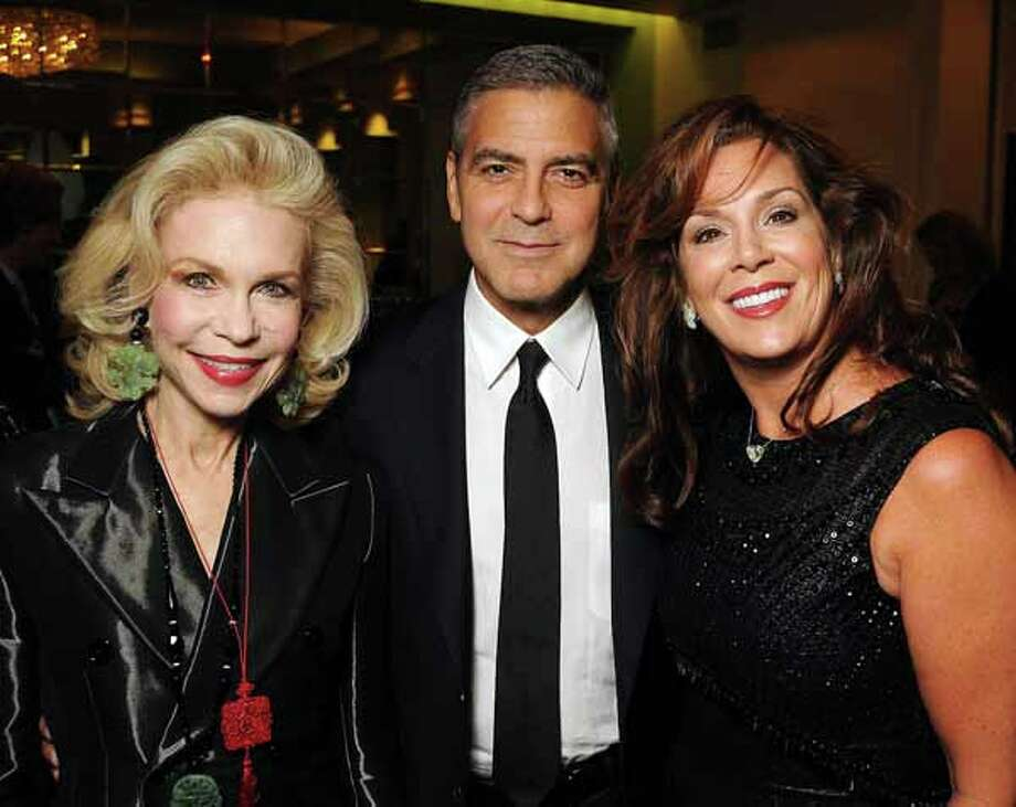 Lynn Wyatt, Geroge Clooney and Cherie Flores before Clooney's 2012  appearance at the Brilliant Lecture Series. Photo: Dave Rossman, For The Chronicle / © 2012 Dave Rossman