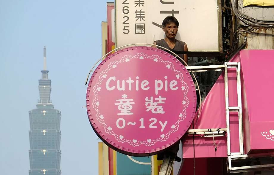 The Cutie Pie caters to the clothing needs of unborn kids to 12 years old in Taipai. Photo: Wally Santana, Associated Press