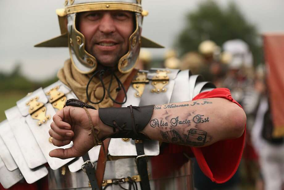 "Latin lover:A Roman legionnaire displays his ""die is cast"" tattoo at the ""History Live!"" event in Northamptonshire, England. ""History Live!"" brings together more than 2,000 re-enactors reliving watershed events in English history, including the Battle of Hastings, Wars of the Roses, Roman conquest and D-Day. Photo: Oli Scarff, Getty Images"