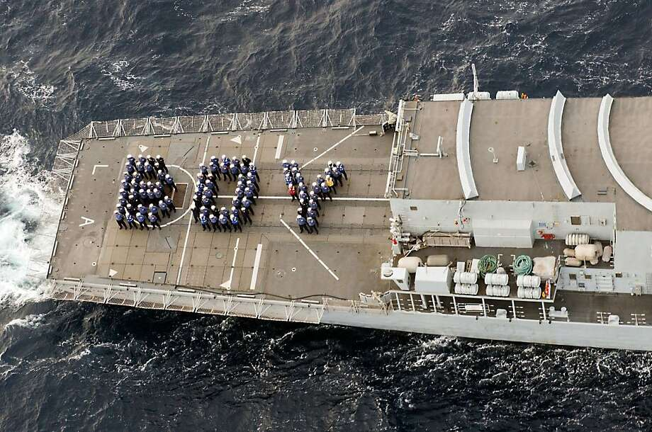 Somewhere in the Caribbean, the British warship HMS Lancaster spells out the good news. Photo: Jay Allen, AFP/Getty Images