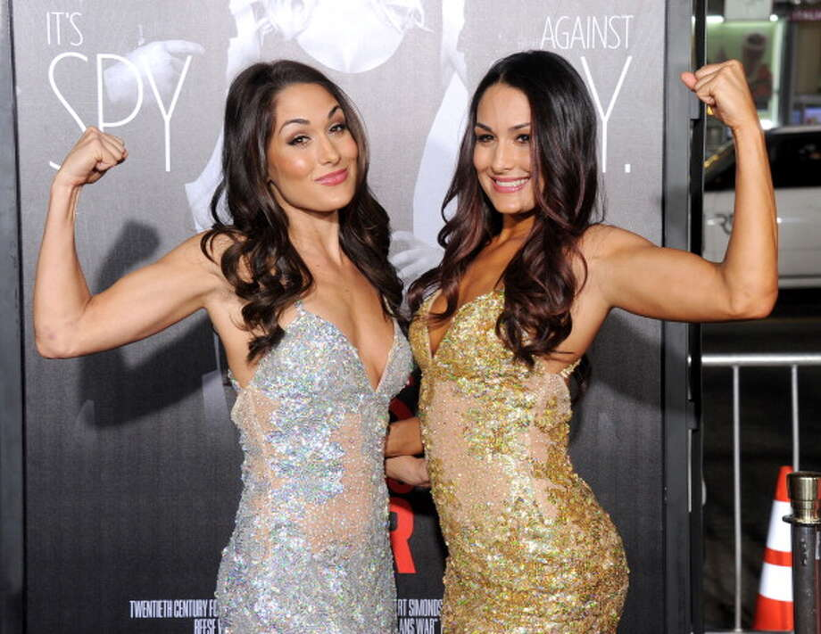 WWE Divas Brie Bella and Nikki Bella are dating Daniel Bryan and John Cena in real life. Photo: Gregg DeGuire, FilmMagic / 2012 Gregg DeGuire