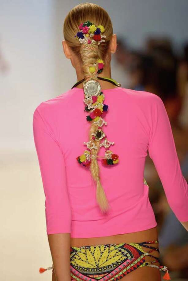 This hair wrap can double as a fishnet. Photo: Frazer Harrison, Getty Images For Mercedes-Benz Fashion Week Swim 2014 / 2013 Getty Images
