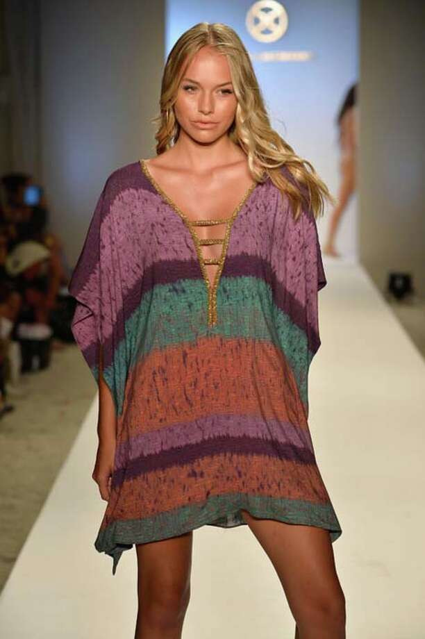This smock-like cover up is practical and beautiful. Photo: Frazer Harrison, Getty Images For Mercedes-Benz Fashion Week Swim 2014 / 2013 Getty Images