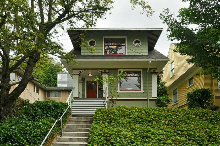 Capitol Hill contains some of Seattle's grandest, and priciest, early 20th-century homes. Here are four listed at what is, for the area, a relatively modest amount, under $800,000.First comes 710 Summit Ave. E. The 2,290-square-foot house, built in 1904, has three bedrooms, 2.25 bathrooms, a family room, extensive updates, radiators, wainscoting, a front porch and a back patio. It's listed for $795,000. Photo: Stefan Enriquez,  Courtesy John Blacksmith,  Lake & Co.
