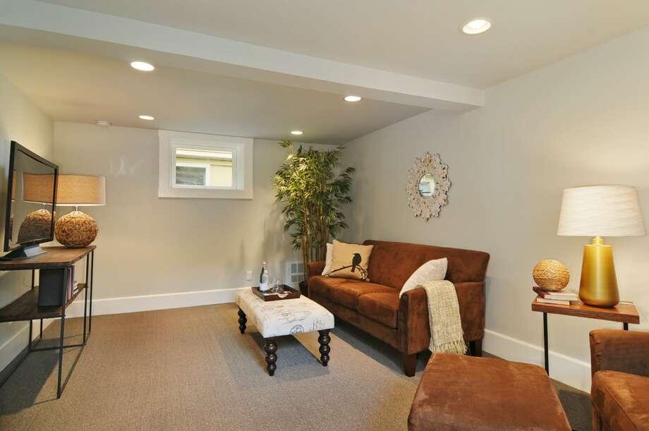 Family room of 710 Summit Ave. E. It's listed for $795,000. Photo: Stefan Enriquez, Courtesy John Blacksmith, Lake & Co.