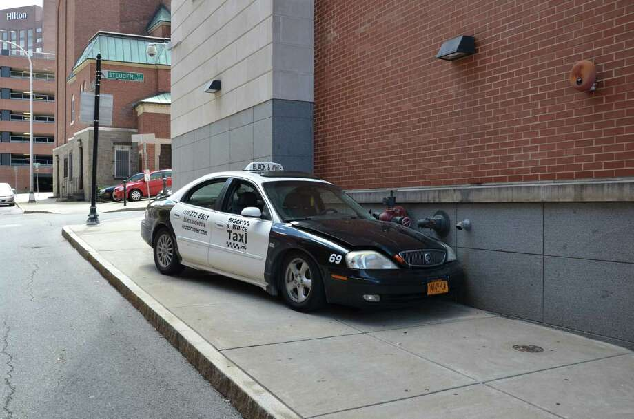 A Black and White cab came to rest after hitting the Albany County Judicial Center on Chapel Street on Tuesday, July 23, 2013, in Albany, NY. Sheriff Craig Apple said the driver fell asleep. (Albany County Sheriff's Department photo)