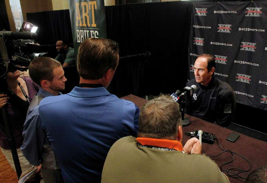 Baylor coach Art Briles talks to reporters during a breakout session at the Big 12 Conference football media days Tuesday, July 23, 2013, in Dallas. (AP Photo/Tim Sharp) Photo: Tim Sharp, Associated Press / FR62992 AP