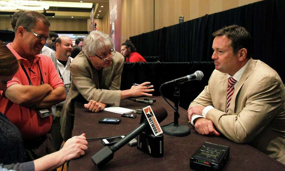 Oklahoma coach Bob Stoops talks to reporters during a breakout session at the Big 12 Conference football media days Tuesday, July 23, 2013 in Dallas.  (AP Photo/Tim Sharp) Photo: Tim Sharp, Associated Press / FR62992 AP